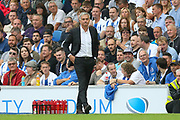 a grim faced Manchester United Manager Jose Mourinho during the Premier League match between Brighton and Hove Albion and Manchester United at the American Express Community Stadium, Brighton and Hove, England on 19 August 2018.