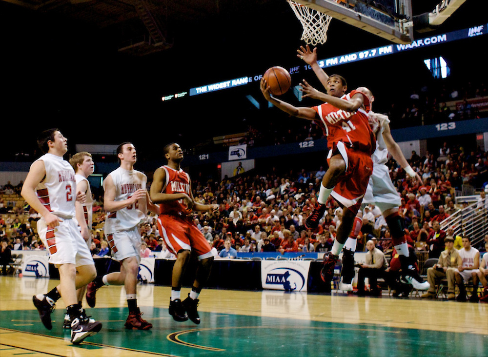 (031409  Worcester, Mass.) D2BHOOPS     Milton forward DJ Santos goes for a reverse layup against Hoosac at the MIAA Division 2 State Championships at the DCU Center in Worcester on March 14, 2009. Herald Photo by KELVIN MA. Saved in Sunday.