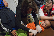 Greece, Idomeni, Refugees on their way to Europe,   Children in Idomeni<br /> <br /> Childdoctor is checking a 13 month old syrian girl Merjam, <br /> Idomeni, is the eye of a needle for getting to nothern Europe. <br /> Children from Syria, Afghanistan and Irak in Idomeni, suffer under the circumstances of heavy rain, cold nights, no dry spaces. Most of them get sick. <br /> <br /> Red Cross Team from Hungry during their shift at the Emergency Room, Hospital which is a small tent. Difficult cases will be taken to the hospitals in Polycastro or Thessaloniki.<br /> <br /> <br /> <br /> <br /> <br /> keine Veroeffentlichung unter 50 Euro*** Bitte auf moegliche weitere Vermerke achten***Maximale Online-Nutzungsdauer: 12 Monate !! <br /> <br /> for international use:<br /> Murat Tueremis<br /> C O M M E R Z  B A N K   A G , C o l o g n e ,  G e r m a n y<br /> IBAN: DE 04 370 800 40 033 99 679 00<br /> SWIFT-BIC: COBADEFFXXX