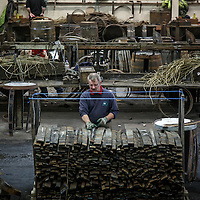 Coopers repair used barrels at Speyside Cooperage, Craigellachie, Scotland, July 13, 2015. Gary He/DRAMBOX MEDIA LIBRARY