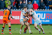 Castleford Tigers winger Greg Minikin (2) is stopped during the Betfred Super League match between Castleford Tigers and Widnes Vikings at the Jungle, Castleford, United Kingdom on 11 February 2018. Picture by Simon Davies.