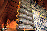 The toes and feet of the giant reclining Buddha statue at Wat Pho, Bangkok, Thailand.