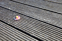 Dropped pacifier on wooden flooring