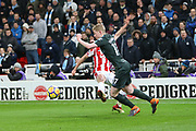 Kevin de Bruyne passes Joe Allen during the Premier League match between Stoke City and Manchester City at the Bet365 Stadium, Stoke-on-Trent, England on 12 March 2018. Picture by Graham Holt.