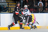 KELOWNA, CANADA - FEBRUARY 28: Dillon Dube #19 of Kelowna Rockets checks Micheal Zipp #4 of Calgary Hitmen  on February 28, 2015 at Prospera Place in Kelowna, British Columbia, Canada.  (Photo by Marissa Baecker/Shoot the Breeze)  *** Local Caption *** Micheal Zipp; Dillon Dube;