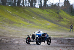 © Licensed to London News Pictures. 28/01/2018. Weybridge, UK. Competitor Miss Abby Oliver drives a 1929 Austin Seven Special on the moss covered historic banked track at Brooklands Museum as she takes part in The Vintage Sports-Car Club's New Year driving tests.  Photo credit: Peter Macdiarmid/LNP