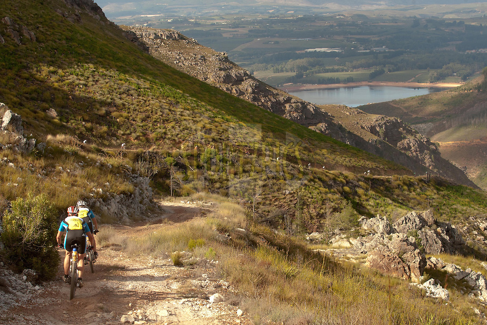 Riders descend towards Grabouw during the final stage (stage 7 ) of the 2011 Absa Cape Epic Mountain Bike stage race held from Oak Valley to Lourensford, South Africa on the3rd April  2011..Photo by Greg Beadle/Cape Epic/SPORTZPICS