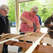 The volunteers review boat building steps in preparation for helping the families to build their boats.