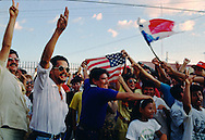 Panamanians celebrate after the surrender of troops loyal to General Manuel Noriega in the town of David during the US invasion of Panama, December 1989.