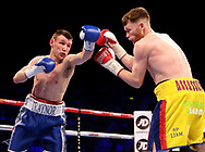 James Tennyson (right) in action against Darren Traynor during their WBA International Super-Featherweight Championship at the SSE Arena, Belfast.