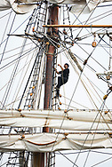 SCHEVENINGEN, NETHERLANDS, 16 JUNE 2020.  Expedition leader Jordi Plana Morales climbs into the mast. Dutch Historical tall ship Bark Europa arrives in the home port of Scheveningen after an 82 days non-stop sailing expedition. Being denied accesss in Ushuaia, Argentina and most other ports due to Covid-19 quarantine and with no place to go, the ship had to sail back the 10.000 miles to The Netherlands. With no ports to resupply and just powered by the wind, this epic journey has never been done before.  © Photo by Frits Meyst  /  WideOyster.com for Bark Europa.