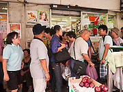 09 JULY 2011 - BANGKOK, THAILAND: People walk by a 7-11 in the Chinatown section of Bangkok, Thailand. Chinatown is the entrepreneurial hub of Bangkok, with thousands of family owned businesses selling wholesale merchandise in everything from food like rice, peanuts and meats, to dry goods like toys and shoes.  PHOTO BY JACK KURTZ