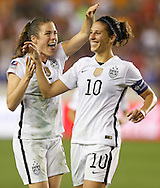 Feb 19, 2016; Houston, TX, USA; USA defender Kelley O'Hara (5) celebrates USA midfielder Carli Lloyd (10) goal against Trinidad & Tobago in the first half during the semifinals of the 2016 CONCACAF women's Olympic soccer tournament at BBVA Compass Stadium.  Mandatory Credit: Thomas B. Shea-USA TODAY Sports