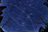 Winter Nighttime Sky Over New Jersey. Composite star trail image (20:30 - 20:59) taken with a Nikon D850 camera and 8-15 mm fisheye lens (ISO 800, 15 mm, f/8, 30 sec). Raw images processed with Capture One Pro and the composite created with Photoshop CC (statistics, maximum).