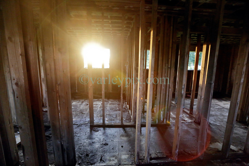 20 August 2015. New Orleans, Louisiana. <br /> Hurricane Katrina revisited. <br /> A decade later and recovery remains largely elusive for the area hardest hit by Katrina. Sunlight streams through an abandoned house once flooded by the storm.<br /> Photo credit©; Charlie Varley/varleypix.com.