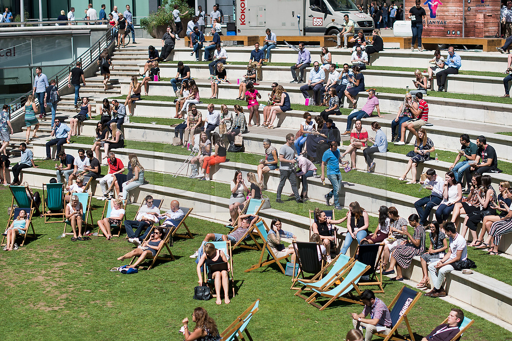 © Licensed to London News Pictures. 02/08/2018. London, UK. Workers enjoy the sunshine at lunch time in Paddington Basin in London. Another heatwave is expected to hit parts of the UK with record temperatures expected in parts of Europe. Photo credit: Ben Cawthra/LNP