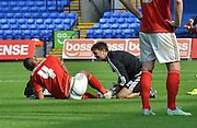 Michael Mancienne gets medical attention during the Sky Bet Championship match between Bolton Wanderers and Nottingham Forest at the Macron Stadium, Bolton, England on 22 August 2015. Photo by Mark Pollitt.