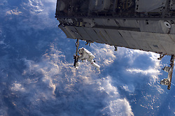 February 6, 2018 - Space - Released Today: NASA astronaut Robert Curbeam works on the International Space Station's S1 truss during the space shuttle Discovery's STS-116 mission in Dec. 2006. During Discovery's mission to the station, the STS-116 crew continued construction of the orbital outpost, adding the P5 spacer truss segment during the first of four spacewalks. The next two spacewalks rewired the station's power system, preparing it to support the station's final configuration and the arrival of additional science modules. A fourth spacewalk was added to allow the crew to retract solar arrays that had folded improperly. (Credit Image: © NASA/ZUMA Wire/ZUMAPRESS.com)
