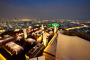 State Tower. Sirocco Restaurant offers a splendid open air panoramic of Bangkok at dusk.