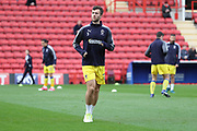 AFC Wimbledon defender Jon Meades (3) warming up during the EFL Sky Bet League 1 match between Charlton Athletic and AFC Wimbledon at The Valley, London, England on 28 October 2017. Photo by Matthew Redman.