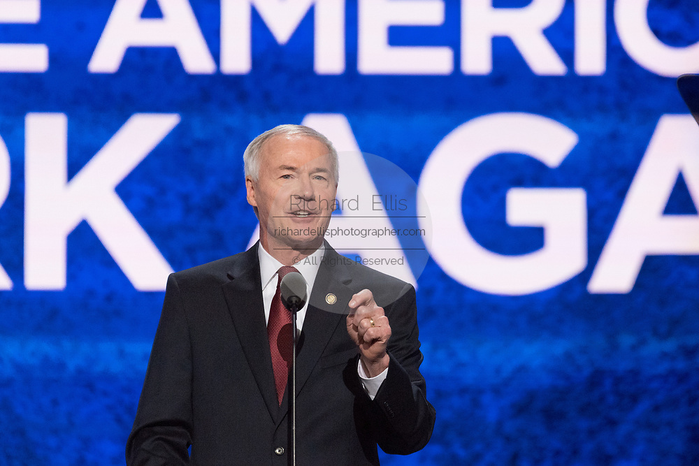 Gov. Asa Hutchinson of Arkansas addresses delegates during the roll call on the second day of the Republican National Convention July 19, 2016 in Cleveland, Ohio. The delegates formally nominated Donald J. Trump for president after a state by state roll call.
