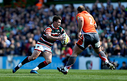 Freddie Burns of Leicester Tigers takes on Kyle Cooper of Newcastle Falcons - Mandatory by-line: Robbie Stephenson/JMP - 15/04/2017 - RUGBY - Welford Road - Leicester, England - Leicester Tigers v Newcastle Falcons - Aviva Premiership