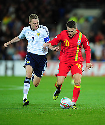 Wales Joe Allen (Liverpool) battles for the ball with Scotland's Darren Fletcher (Manchester United) - Photo mandatory by-line: Joe Meredith/JMP  - Tel: Mobile:07966 386802 12/10/2012 - Wales v Scotland - SPORT - FOOTBALL - World Cup Qualifier -  Cardiff   - Cardiff City Stadium -