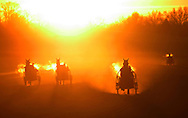 Town of Wallkill, New York  - Harness racing horses work out as the sun rises in the background on a cold morning at the Mark Ford Training Center on  Dec.12, 2011.