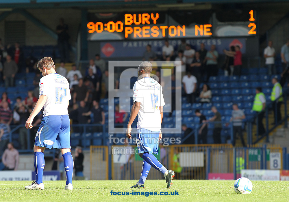Picture by Michael Sedgwick/Focus Images Ltd +44 7900 363072.08/09/2012.Dejected Bury players leave the pitch after their 2-1 loss against Preston North End after the npower League 1 match at Gigg Lane, Bury.