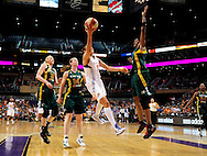 Sep 17 2011; Phoenix, AZ, USA; Phoenix Mercury  guard Diana Taurasi (3) puts up a shot against the Seattle Storm  forward .Lauren Jackson (15) , guard Katie Smith (14) and forward Swin Cash (2) during the first half at the US Airways Center.  The Mercury defeated the Storm 92 - 83. Mandatory Credit: Jennifer Stewart-US PRESSWIRE