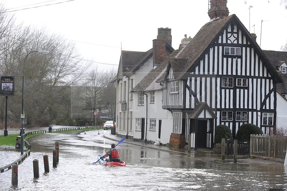 &copy; Licensed to London News Pictures. 24/12/2013<br /> Local resident Giles Wolfe enjoying some canoeing in the road outside The Plough Pub in Eynsford,Kent. ( today 24.12.2013) <br /> Eynsford Village Flooding in Kent.<br /> The River Darent in Eynsford has flooded and closed the village ford due to heavy rain overnight.<br /> The UK  has woken up to trees and electricity cables down following a night of gale-force winds and torrential rain.<br /> Photo credit :Grant Falvey/LNP