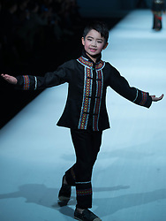 A child model presents a creation by designer Xu Xinyin during the Children's Ethnic Apparel Collection of the China Fashion Week in Beijing, capital of China, March 31, 2016. EXPA Pictures © 2016, PhotoCredit: EXPA/ Photoshot/ Li Jianbo<br /> <br /> *****ATTENTION - for AUT, SLO, CRO, SRB, BIH, MAZ, SUI only*****