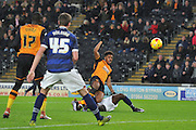 Hull City striker Chuba Akpom scores to 1-0 up  during the Sky Bet Championship match between Hull City and Bolton Wanderers at the KC Stadium, Kingston upon Hull, England on 12 December 2015. Photo by Ian Lyall.
