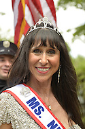 Merrick, New York, U.S. - May 26, 2014 - JANE RUBINSTEIN, Ms. NY Senior America, marches in The Merrick Memorial Day Parade and Ceremony, hosted by American Legion Post 1282 of Merrick, honoring those who died in war while serving in the United States military. Rubinstein is from Merrick.
