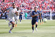Liverpool defender Virgil van Dijk (4) chases the ball with Manchester United Forward Alexis Sanchez during the Manchester United and Liverpool International Champions Cup match at the Michigan Stadium, Ann Arbor, United States on 28 July 2018.