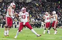 Nebraska's Tanner Lee, No. 13, cheers after throwing the game-winning touch down pass to Stanley Morgan Jr. against Purdue. Nebraska played Purdue University in a football game Ross&ndash;Ade Stadium on Saturday, Oct. 28, 2017, in West Lafayette, Indiana. <br /> <br /> MATT DIXON/THE WORLD-HERALD