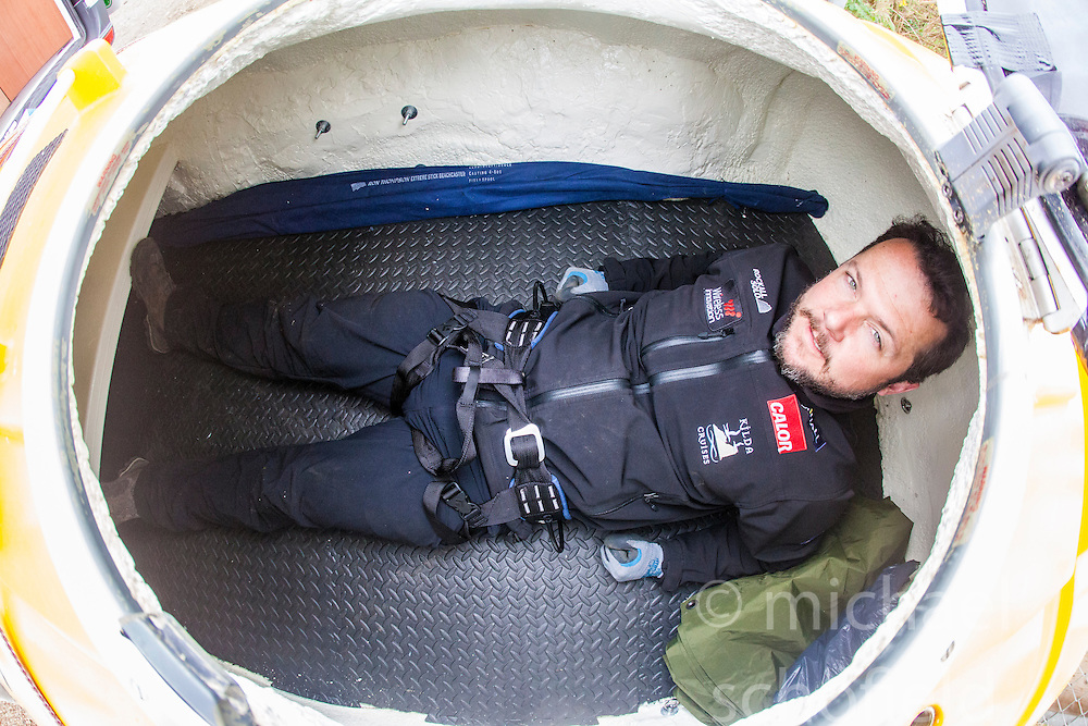 Nick Hancock inside his Rock Pod, at the Edinburgh International Climbing Arena, getting some practise his 60 day Rockall Solo 2014 endurance expedition. Nick will use the Rock Pod, a modified plastic water tank, to live for two months on Rockall, a uninhabited remote granite islet, hundreds of miles off Scotland in the north Atlantic, in order to raise funds for Help for Heroes.