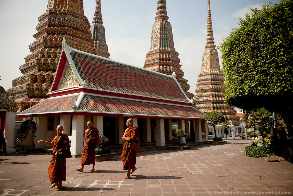 Monks at Wat Pho, home of a reclining Buddha 46 meters long and 15 meters tall, in Bangkok, Thailand.
