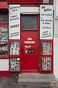 Traditional seafront holiday trinket and seaside memento shop doorway on Pier Hill at Southend-on-Sea, Essex.