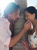 Man touching woman's face half-length