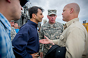 The Governor of Louisiana Bobby Jindal talks with Colonel Edward Fleming from the Army Corps of Engineering and New Orleans Mayor Mitch Landrieu at the 17th street canal pumping station in New Orleans, where the levee was breached during the Hurricane Katrina. Thanks to the Army Corps of Engineers, the levee and pumping station are greatly improved after Katrina, and are now expected to be able to stand up to at leas a CAT 3 hurricane. On Tuesday Governor Jindal, who has criticized Barack Obama for excessive federal spending, said the president isn't providing enough funding to cover the costs of Hurricane Isaac.