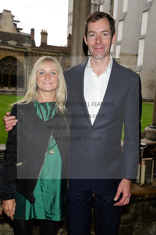"MANDY D'ABO and TED WILSON at a private view to view ""The Coronation Theatre: Portrait of Her Majesty Queen Elizabeth II"" painted by Ralph Heimans held at Westminster Abbey, London on 12th September 2013."