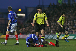 Portsmouth, England - Saturday, February 10, 2007: Portsmouth's Djimi Traore is injured after a tackle by Joey Barton of Manchester City during the Premiership match at Fratton Park. (Pic by Chris Ratcliffe/Propaganda)
