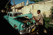 CUBA, SANTIAGO DE CUBA..Pre-revolutionary (early 50s) vintage Pontiac..(Photo by Heimo Aga)