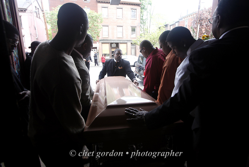 Pallbearers guide the casket bearing the body of Tyrik Omar Legette from the House of Joy Church after his funeral in the City of Newburgh, NY on Friday, May 8, 2009. Legette is the 34 year old man who was stabbed to death on Lander street by a group of youths on April 30th.