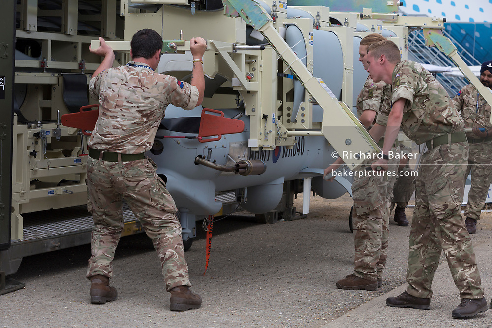 Members of British Army's Royal Artillery, demonstrate the rapid deployment of a Thales Watchkeeper UAV at the Farnborough Airshow, on 18th July 2018, in Farnborough, England.