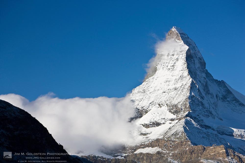 A fog bank encircles the Matterhorn at first light - Zermatt, Switzerland