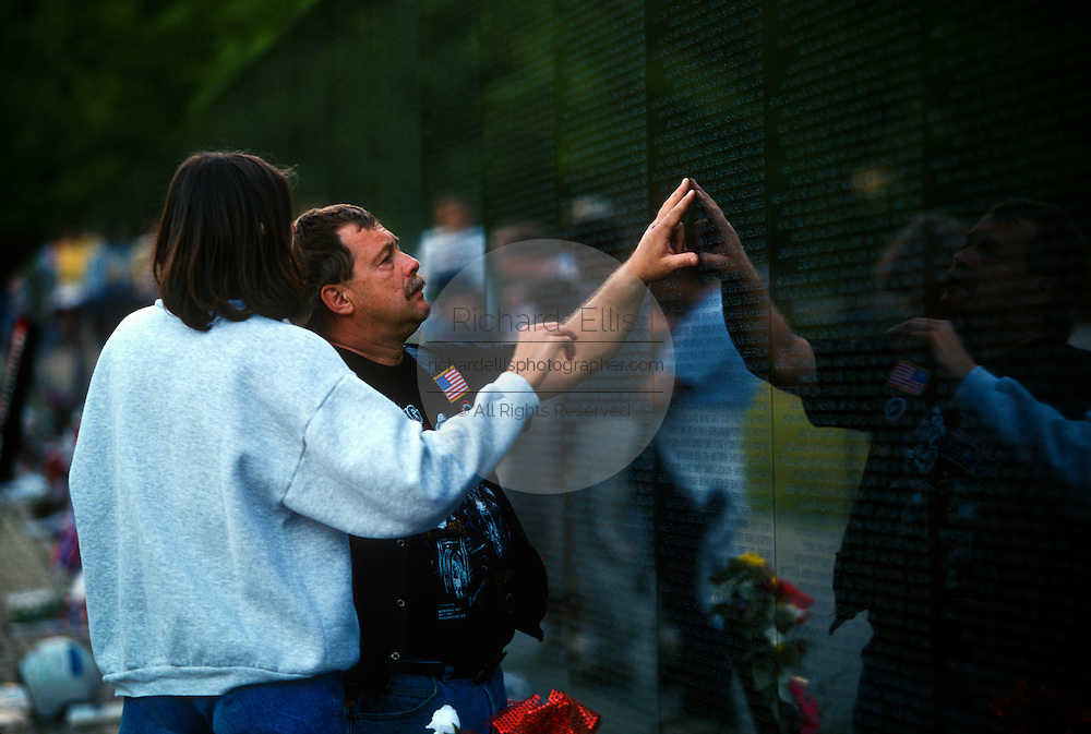 A motorcycle biker at the Vietnam Memorial Wall during Operation Rolling Thunder rally in Washington, DC.