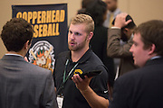 Grant Canning, the general manager of the Copperhead Baseball team, talks to College of Business students at the Career Fair in Baker Ballroom on October 13, 2016.