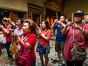 """08 FEBRUARY 2016 - BANGKOK, THAILAND:  People pray for Chinese New Year at Wat Mangon Kamlawat, the largest Mahayana (Chinese) Buddhist temple in Bangkok during the celebration of the Lunar New Year. Chinese New Year is also called Lunar New Year or Tet (in Vietnamese communities). This year is the """"Year of the Monkey."""" Thailand has the largest overseas Chinese population in the world; about 14 percent of Thais are of Chinese ancestry and some Chinese holidays, especially Chinese New Year, are widely celebrated in Thailand.      PHOTO BY JACK KURTZ"""